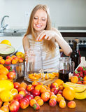 Pretty girl making beverages Royalty Free Stock Image