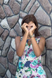 Pretty girl making a heart symbol with her hands Royalty Free Stock Photos