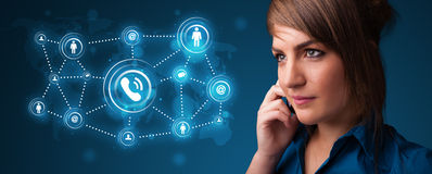 Pretty girl making phone call with social network icons Royalty Free Stock Photo