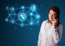 Pretty girl making phone call with social network icons Royalty Free Stock Image