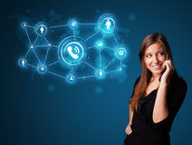 Pretty girl making phone call with social network icons Royalty Free Stock Photography
