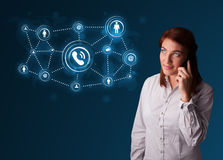 Pretty girl making phone call with social network icons Stock Photo