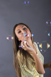 Pretty girl making soap bubbles Royalty Free Stock Photos
