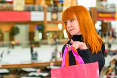 Pretty girl in the mall with  bags. Pretty girl in the mall with colorful bags Royalty Free Stock Photography