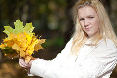 Pretty girl with maple leaves Stock Photography