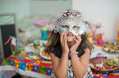 Pretty girl with mask celebrating birthday and having fun Royalty Free Stock Photos