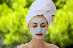 Pretty girl with mask on face Royalty Free Stock Image