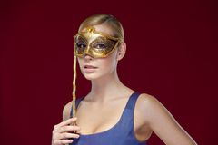 Pretty girl with masquerade mask Royalty Free Stock Photo