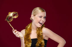 Pretty girl with masquerade mask and tinsel Royalty Free Stock Images