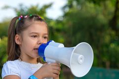 Pretty girl with megaphone Royalty Free Stock Images