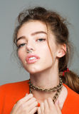 Pretty girl with metallic chain Royalty Free Stock Images