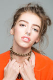 Pretty girl with metallic chain Stock Images