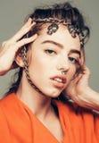 Pretty girl with metallic chain Stock Photos