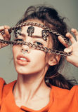 Pretty girl with metallic chain Stock Photo