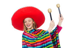 Pretty girl in mexican poncho shaking maracas Royalty Free Stock Photo