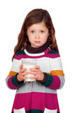 Pretty girl with a milk glass Stock Photos