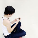 Pretty girl with mobile phone. Thai pretty girl use her mobile phone Royalty Free Stock Photo