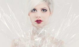 Pretty girl model in plastic Stock Images