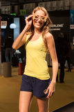 Pretty girl modelling with glasses at Mido 2014 in Milan, Italy Royalty Free Stock Photo