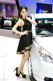 Pretty girl in motor show. Royalty Free Stock Photography