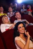 Pretty girl in multiplex movie theater Stock Images