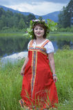 Pretty girl in national dress in a forest royalty free stock images