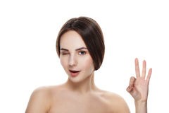 Pretty girl with natural makeup show gesture OKEY. Beautiful spa. Woman touching her face. Perfect fresh skin. Pure beauty model girl. Youth and skin care Royalty Free Stock Images
