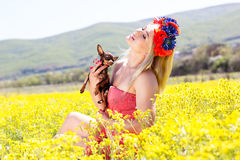 Pretty girl on the nature with her dog Royalty Free Stock Photo