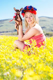 Pretty girl on the nature with her dog Royalty Free Stock Photography
