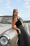 Pretty girl near mother-of-purl car Royalty Free Stock Photos