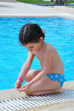 Pretty girl near pool. Pretty girl sit near pool Royalty Free Stock Image