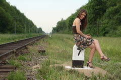Pretty girl near railroad's traffic sign Royalty Free Stock Photos