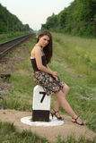 Pretty girl near railroad's traffic sign Royalty Free Stock Photography
