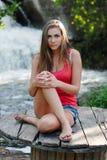 Young woman near waterfall Royalty Free Stock Photo