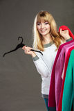 Pretty girl with new wardrobe. Royalty Free Stock Photography