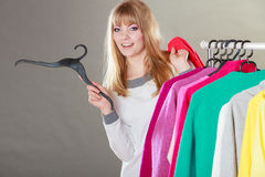Pretty girl with new wardrobe. Stock Image
