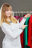 Pretty girl with new wardrobe. Stock Images