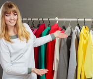 Pretty girl with new wardrobe. Royalty Free Stock Image