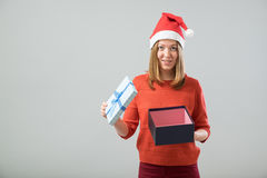 Pretty girl is not satisfied with her gifts Royalty Free Stock Photo
