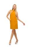 Pretty girl in ocher dress isolated on white Stock Image