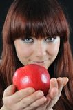 Pretty girl offer red apple stock image