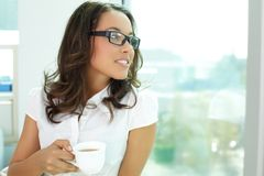 Pretty girl in office Royalty Free Stock Photos
