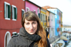 Girl in a scenic city. A pretty girl and one scenic city,as Burano,a venetian island,can be Royalty Free Stock Photo