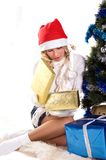 Pretty girl opening christmas gift. Young beautiful woman opening christmas gift Royalty Free Stock Images