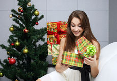 Pretty girl opening gift Royalty Free Stock Photos