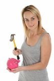 Pretty Girl Opening Piggy Bank with Hammer Royalty Free Stock Photos