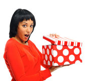Pretty girl opens her box Stock Images