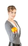 Pretty girl with an orange. Pretty girl hold an orange in her hand; isolated on white background Royalty Free Stock Image