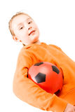 A pretty girl an orange. A pretty girl in an orange tracksuit holding a football Royalty Free Stock Images