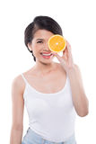 Pretty girl with orange Royalty Free Stock Photos